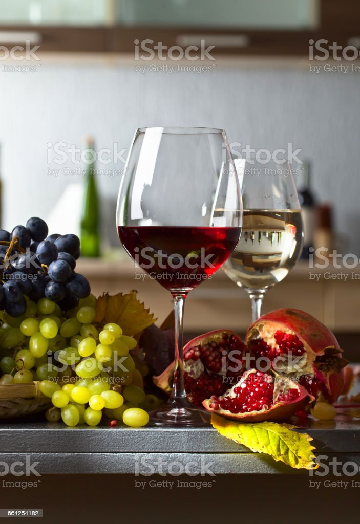 Ripe juicy grapes and glasses of wine stock photo