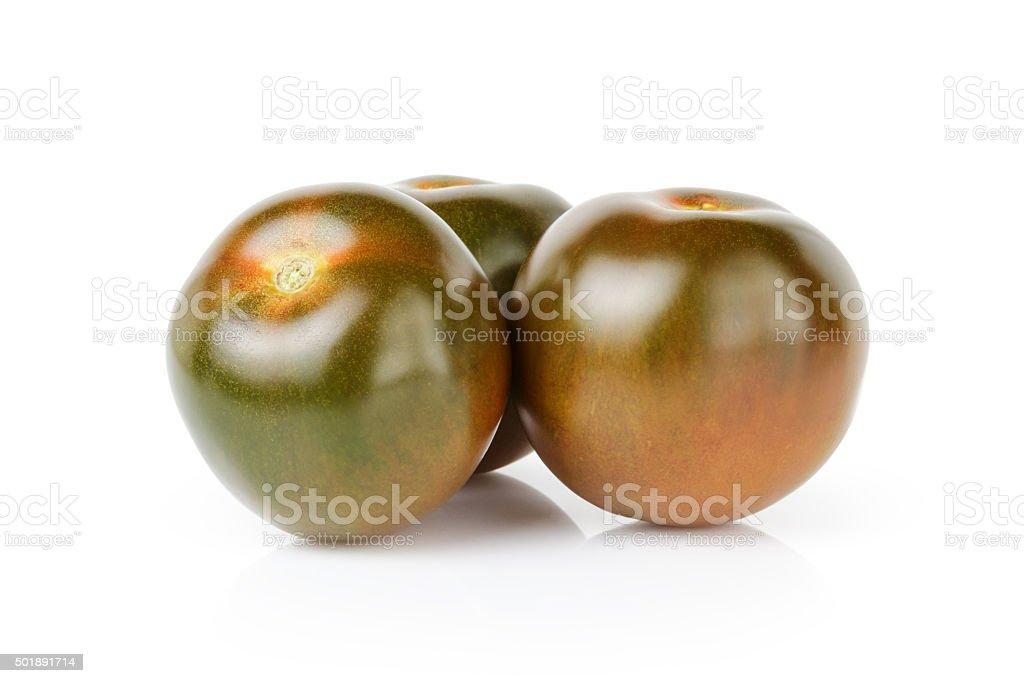 ripe kumato tomatoes isolated on white stock photo