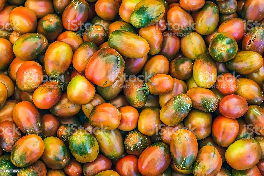 Ripe kumato tomatoes on a market stall stock photo