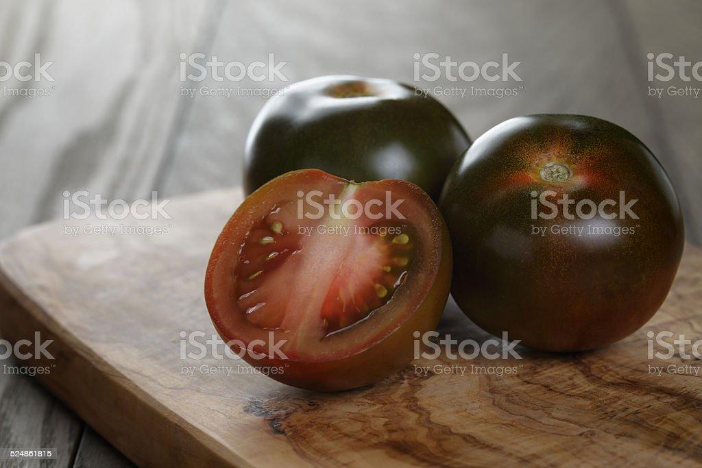 ripe kumato tomatoes stock photo