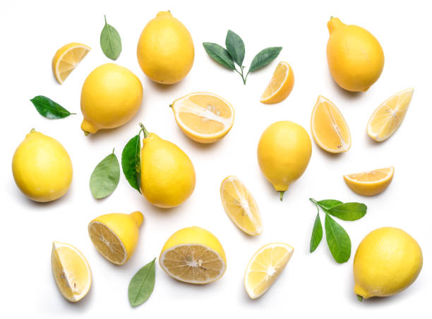 Ripe lemons and lemon leaves. stock photo