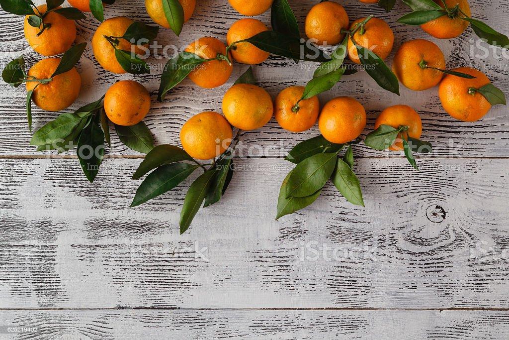 Ripe mandarins on a white wooden table stock photo
