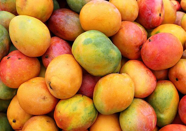 maduro mango frutas - mango fotografías e imágenes de stock