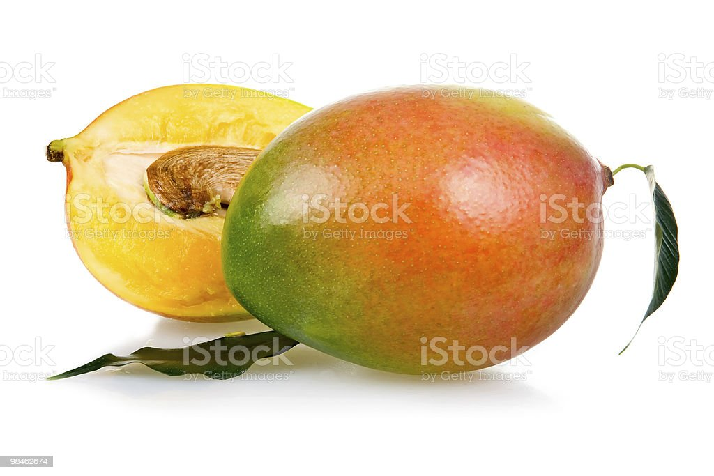 Ripe mango fruits with leaves royalty-free stock photo