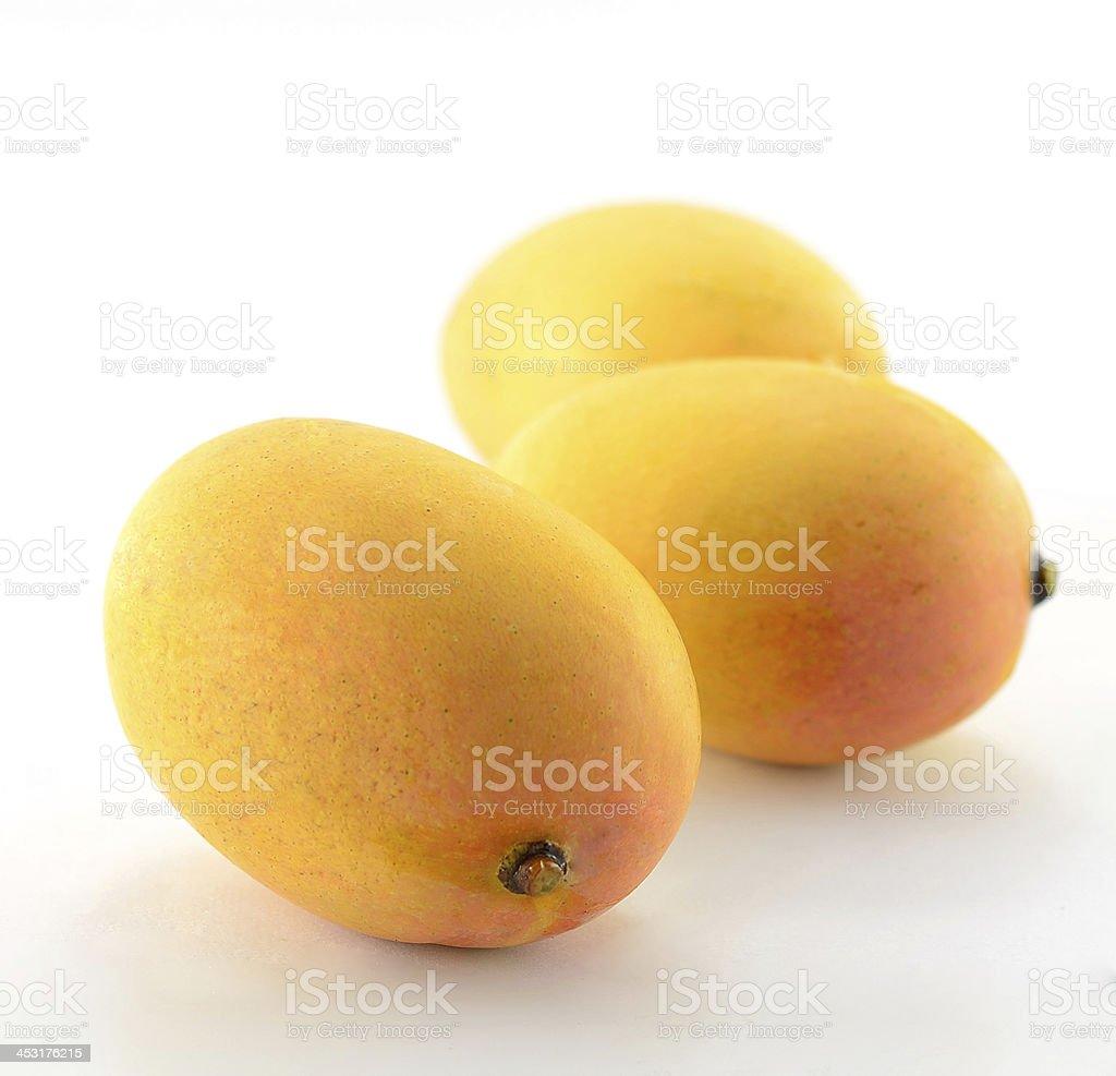 Ripe mangoes isolated on a white background. stock photo