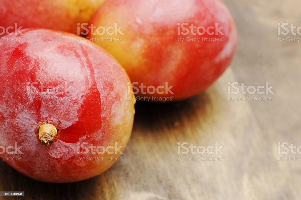 ripe mangos against dark oak, shallow focus royalty-free stock photo