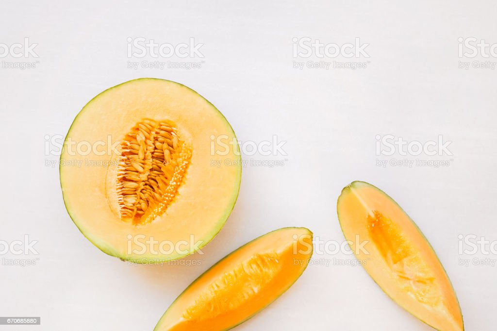 Ripe melon half and slices royalty-free stock photo