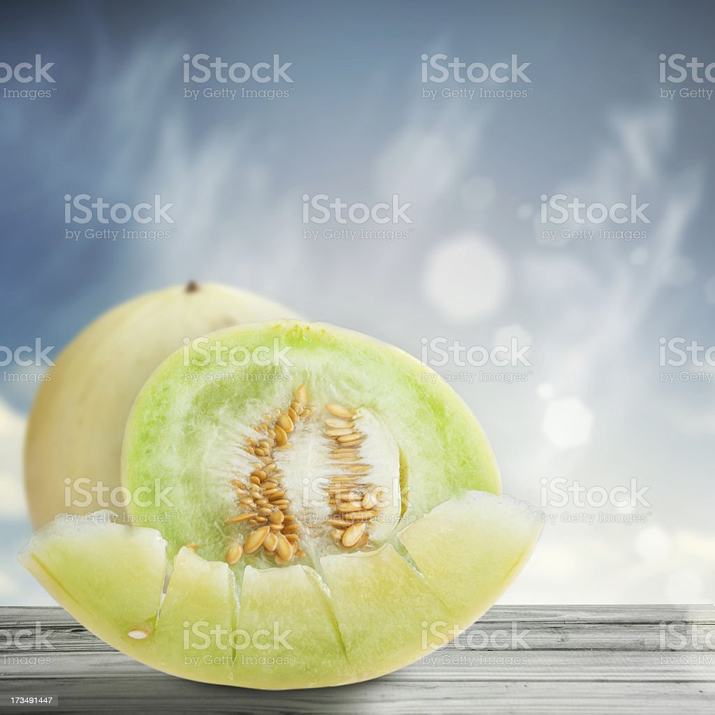 Ripe melon on wooden table royalty-free stock photo