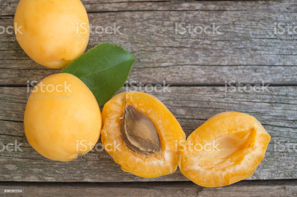 Ripe orange apricots on the wooden background stock photo
