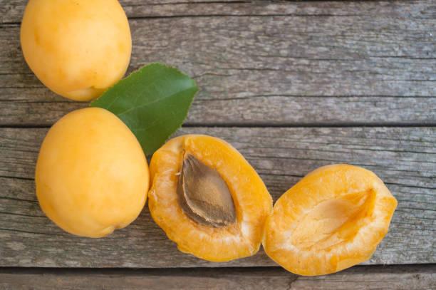 Ripe orange apricots on the wooden background stock photo
