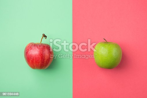 istock Ripe Organic Apples on Split Duotone Green Red Cherry Pink Background. Styled Creative Image. Vitamins Summer Vegan Fashion Concept. Food Poster with Copy Space 961594446
