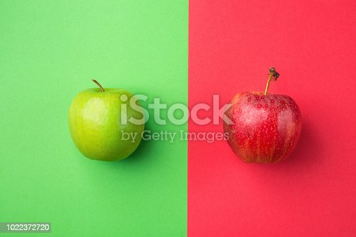 istock Ripe Organic Apples on Split Duotone Green Scarlet Red Background. Styled Creative Image. Vitamins Summer Vegan Fashion Concept. Food Poster with Copy Space 1022372720