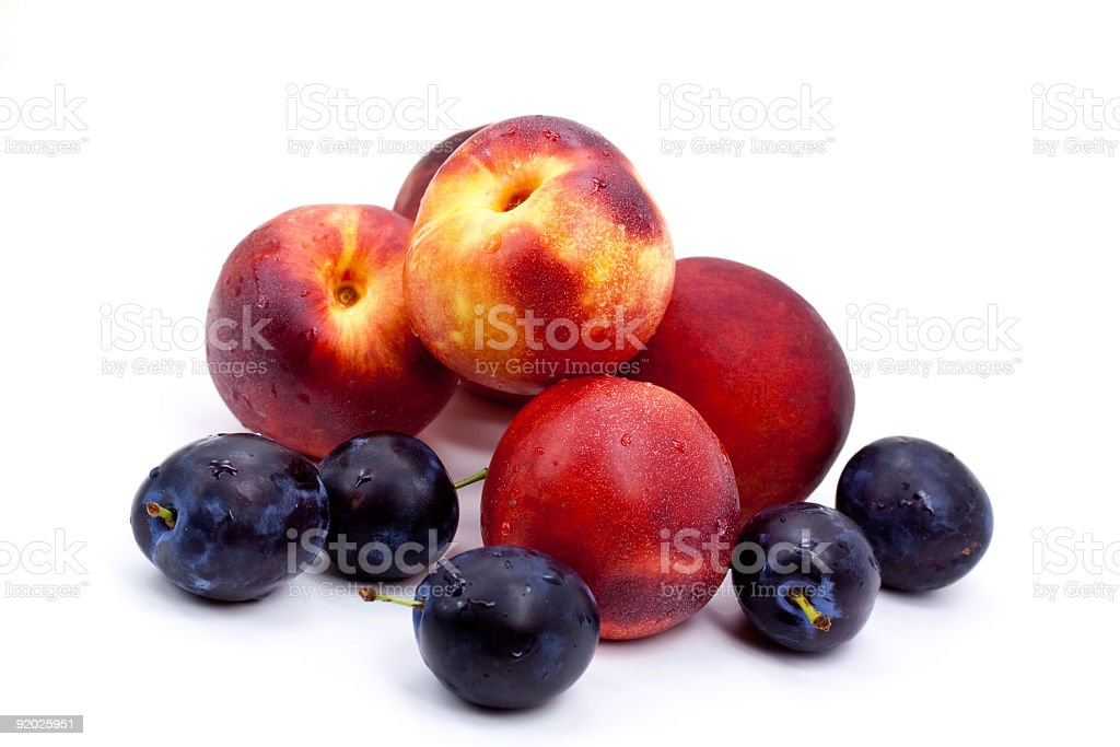 ripe peach and Plums on a white Plate stock photo