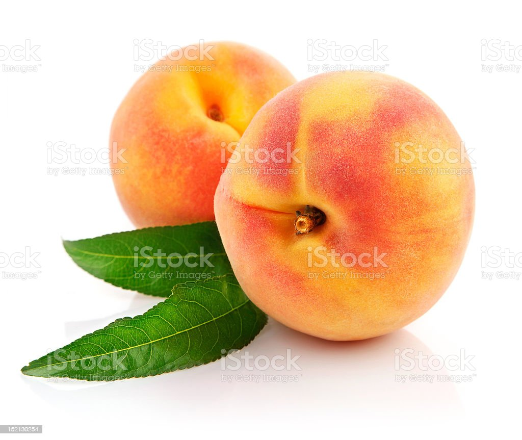 ripe peach fruits with green leaves stock photo