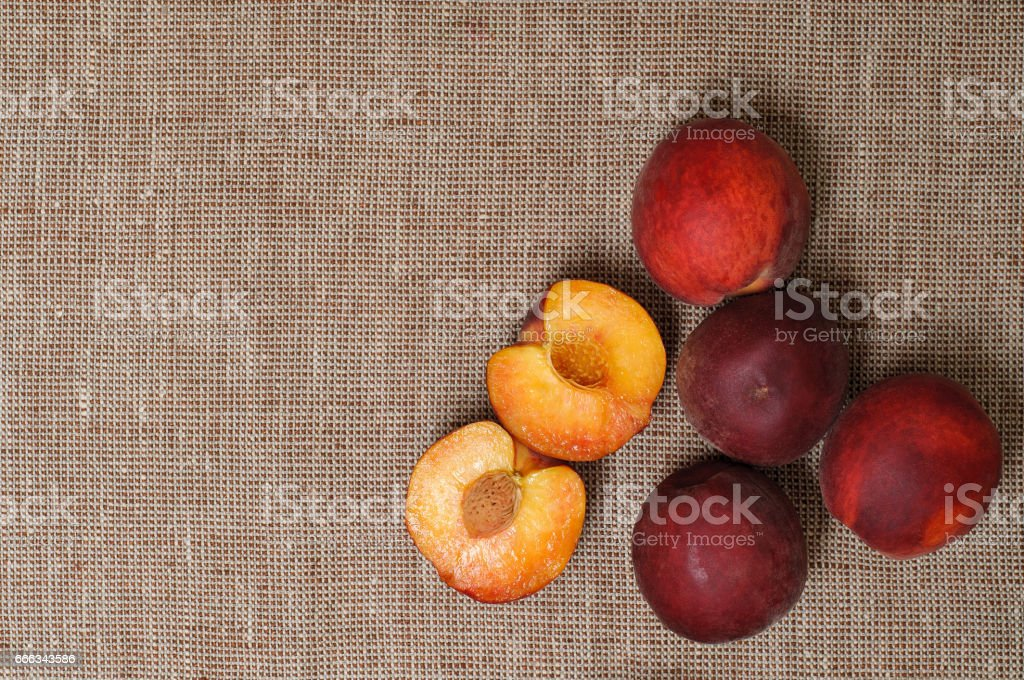 Ripe peaches fruit on a brown  background stock photo