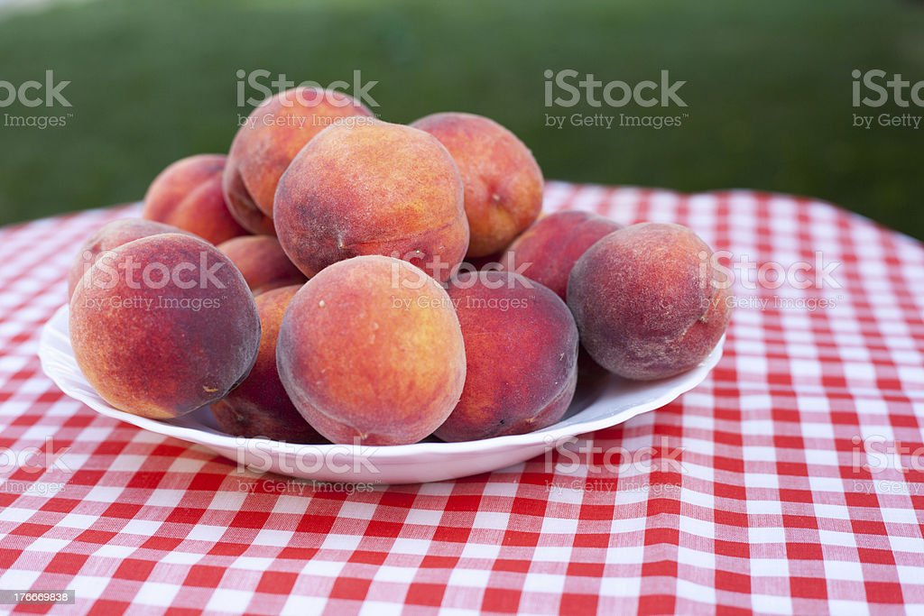 Ripe Peaches on a Plate royalty-free stock photo