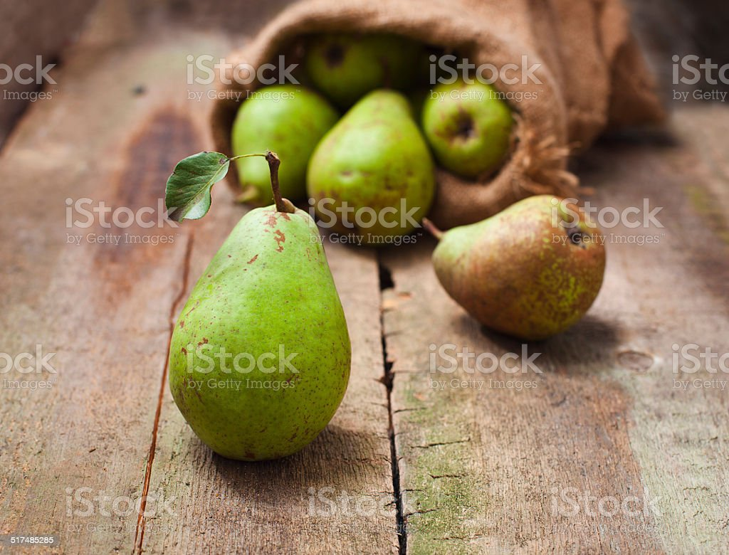 Ripe pear on a wooden background stock photo