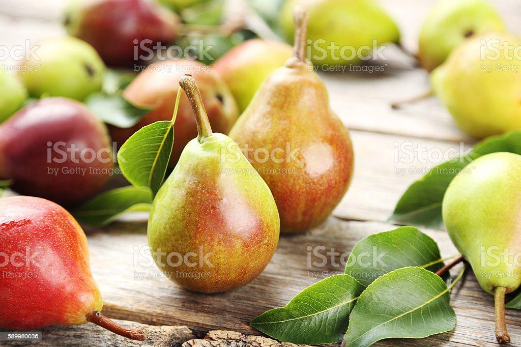 Ripe pears on grey wooden table stok fotoğrafı