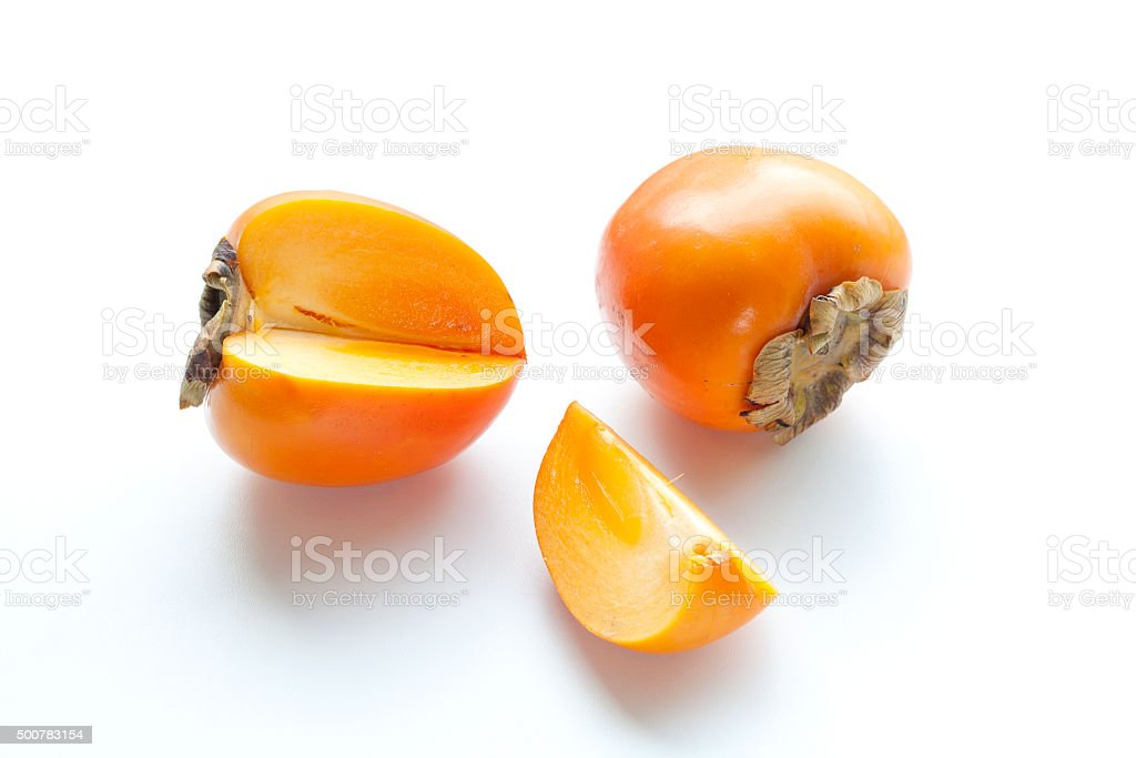 Ripe persimmon with cut isolated on white background. royalty-free stock photo
