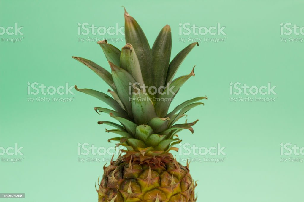 Ripe pineapple against blue background - Royalty-free Above Stock Photo