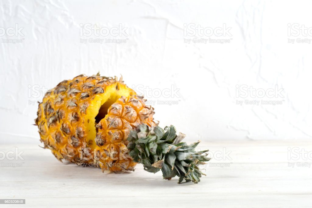 Ripe pineapple on a white wooden table - Royalty-free Antioxidant Stock Photo