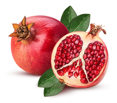 Ripe pomegranate fruit and one cut in half with leaf isolated on white background. Clipping Path. Full depth of field.