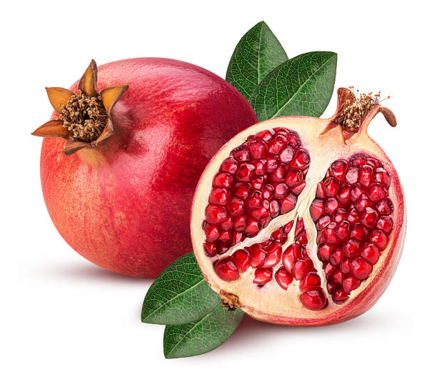 ripe pomegranate fruit and one cut in half with leaf - romã imagens e fotografias de stock