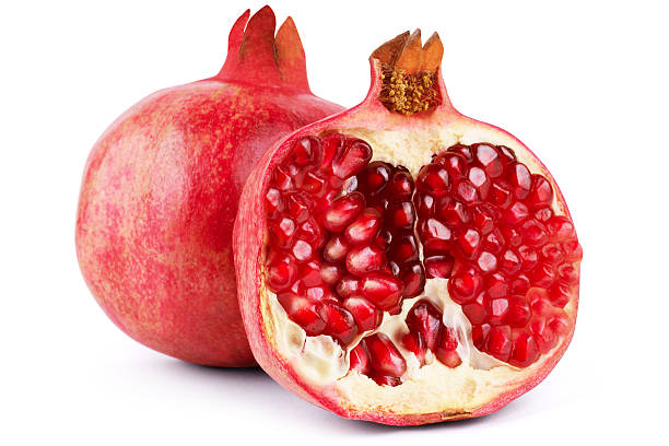 ripe pomegranate fruit isolated on white background cutout - pomegranate stock photos and pictures