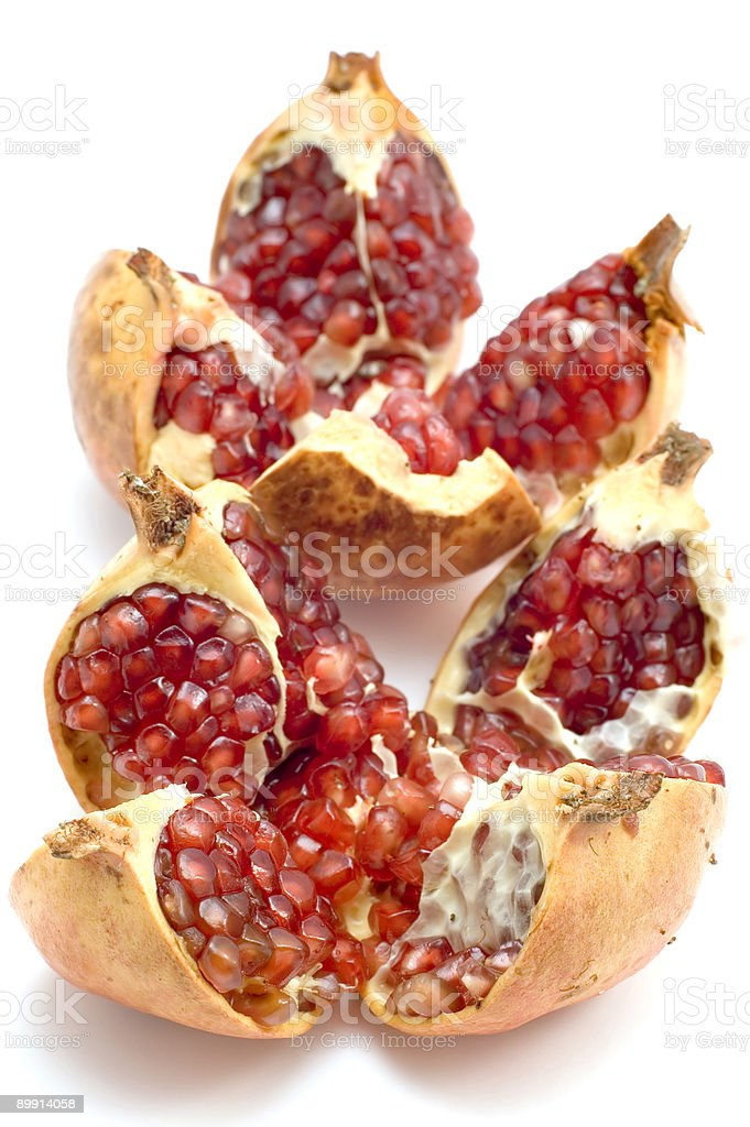 ripe pomegranate on white royalty-free stock photo