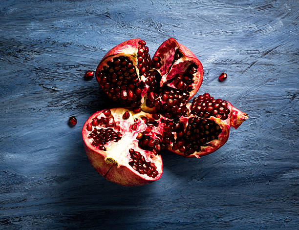 ripe pomegranate - pomegranate stock photos and pictures