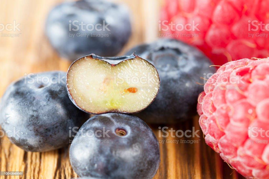 ripe raspberries and blueberries stock photo