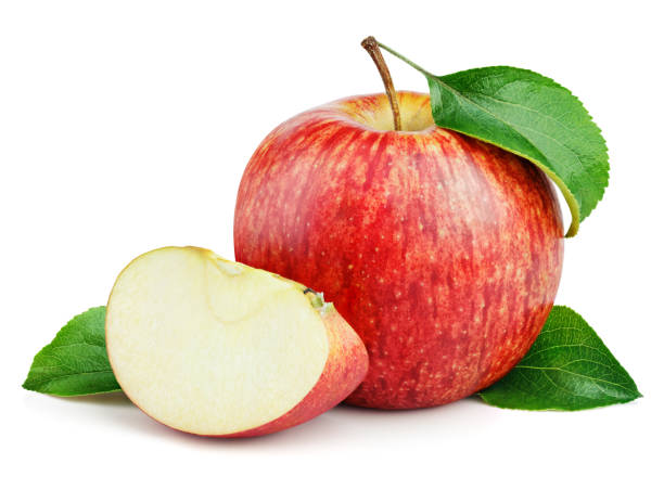 Cтоковое фото Ripe red apple with slice and leaves isolated on white
