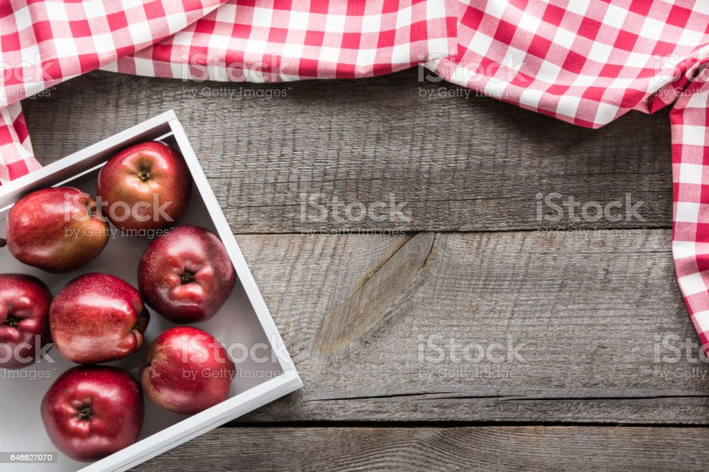 Ripe Red Apples In Birchbox On Wooden Board With Red Checkered