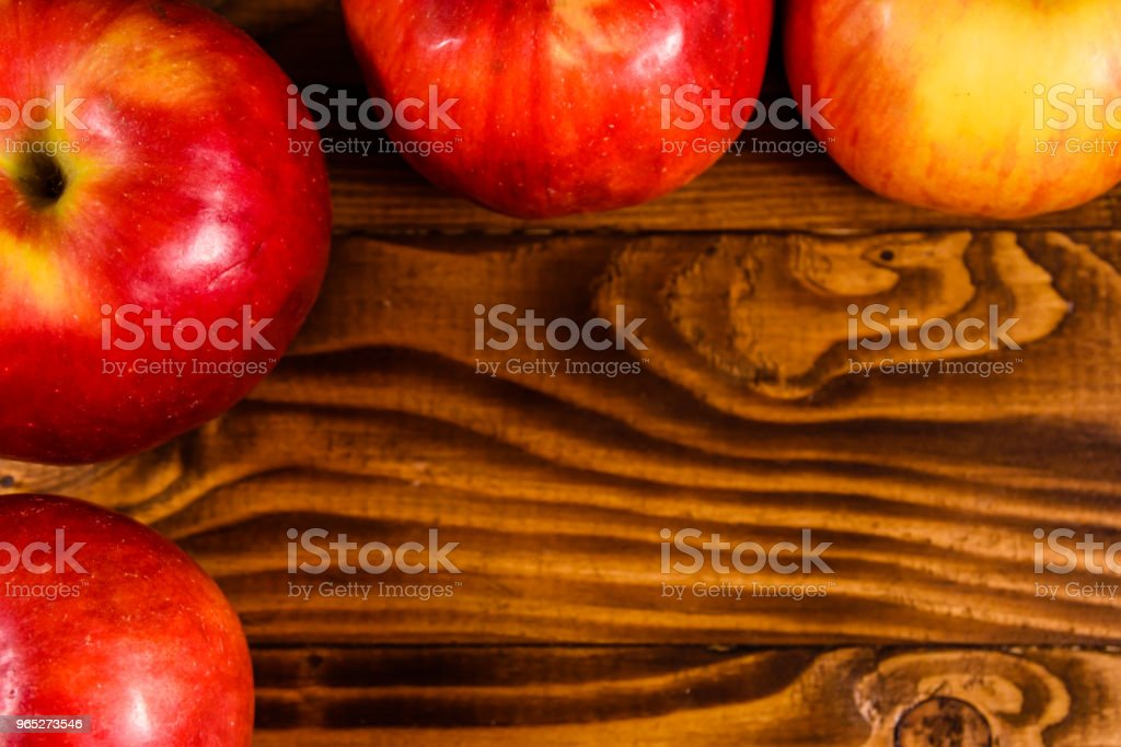 Ripe red apples on the wooden table. Top view royalty-free stock photo