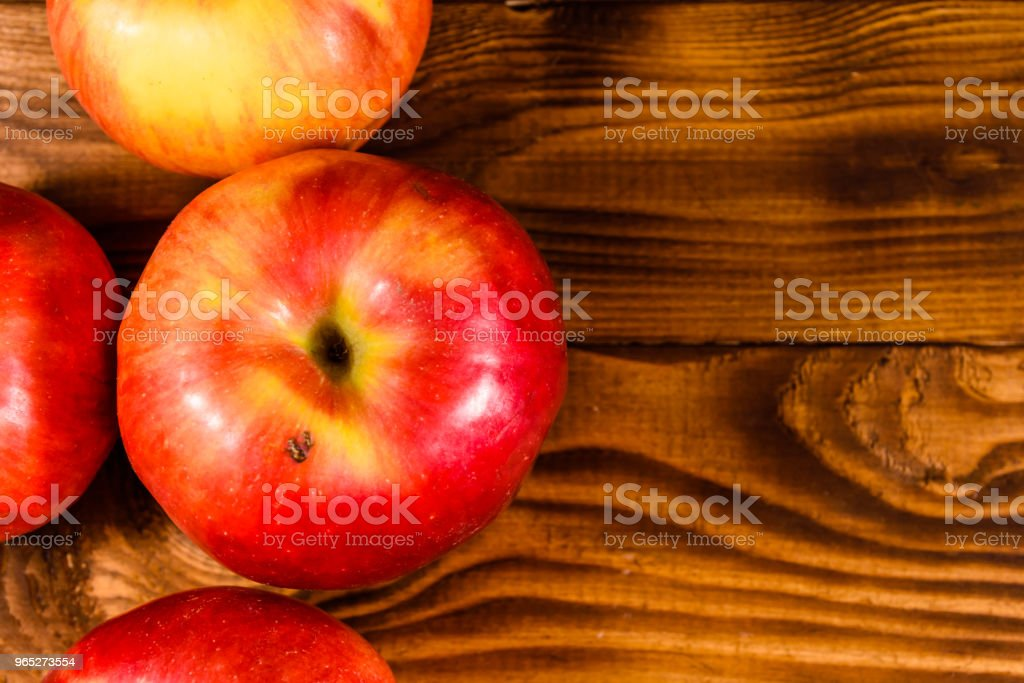 Ripe red apples on the wooden table. Top view zbiór zdjęć royalty-free