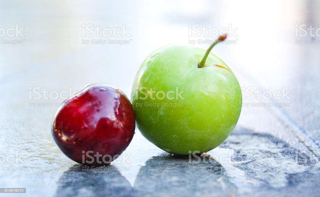 Ripe red cherry and plum stock photo
