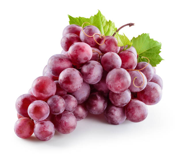 ripe red grape. pink bunch with leaves isolated on white. with clipping path. full depth of field. - grapes fotografías e imágenes de stock