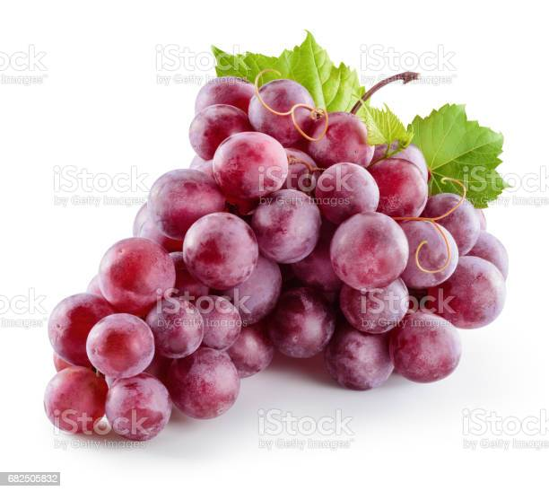 Photo of Ripe red grape. Pink bunch with leaves isolated on white. With clipping path. Full depth of field.