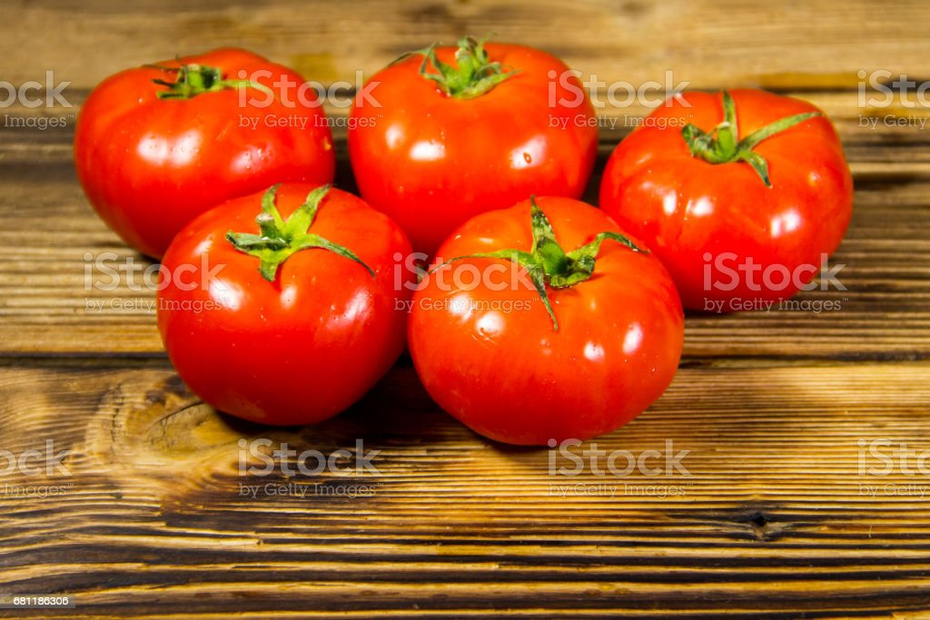 Ripe red tomatoes on wooden table royalty-free stock photo