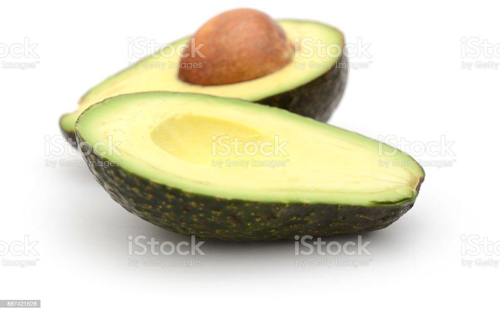 Ripe sliced avocados isolated on white background stock photo