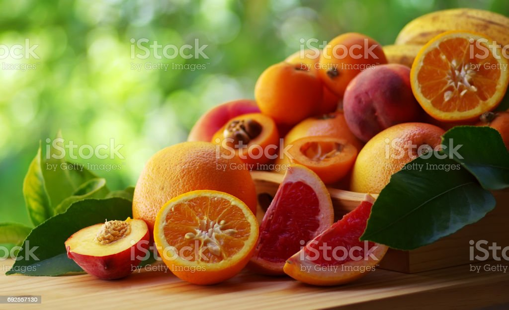 ripe sliced citric fruit and various fruits stock photo