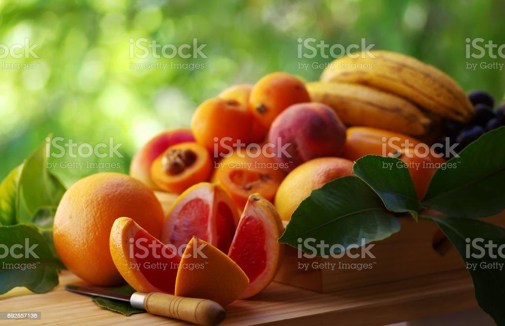 ripe sliced toranja and various fruits stock photo