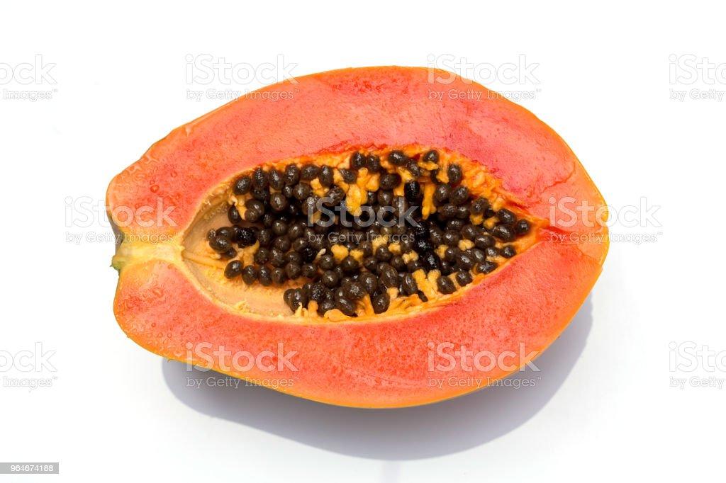 Ripe slices of sweet papaya on white background royalty-free stock photo