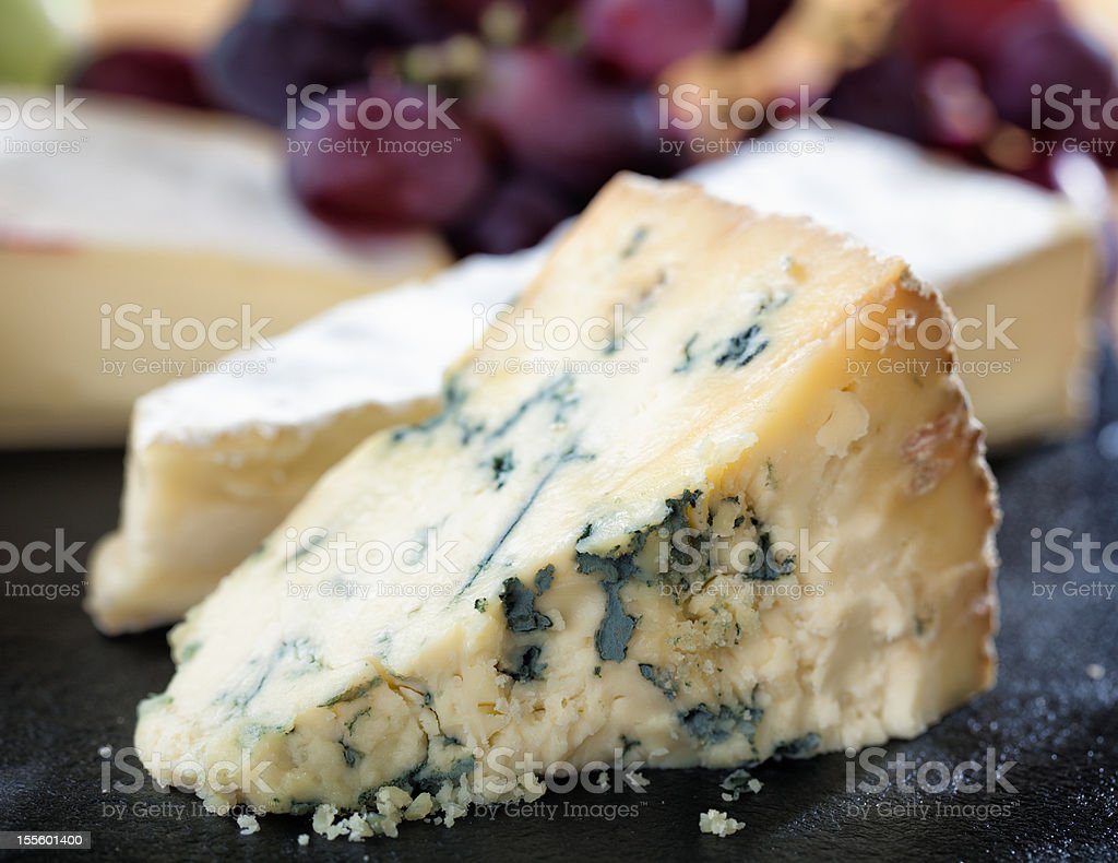 Ripe Stilton on cheeseboard stock photo