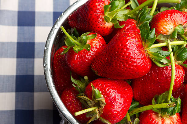 Ripe Strawberries on Blue Gingham stock photo