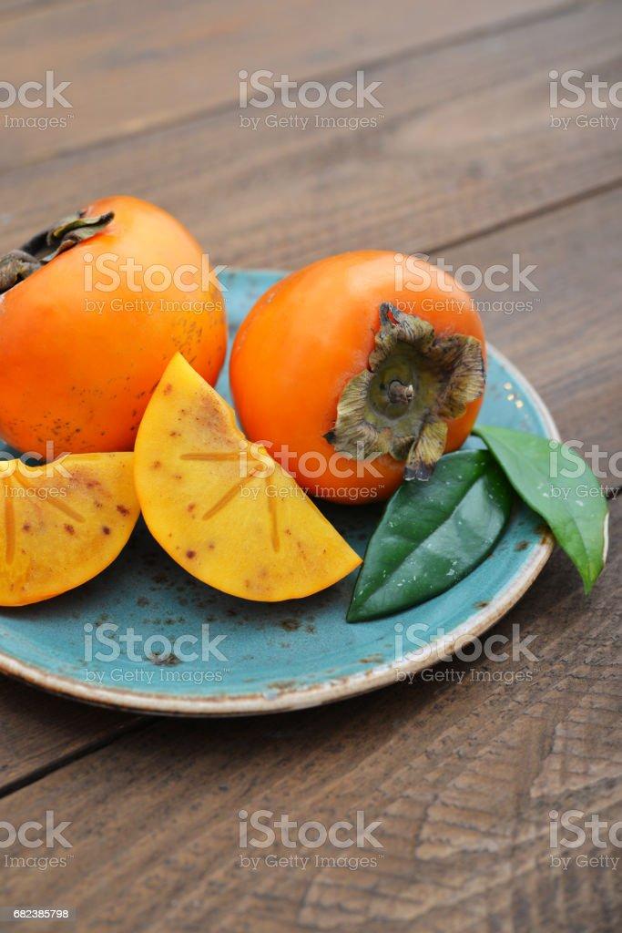 Ripe sweet persimmons zbiór zdjęć royalty-free