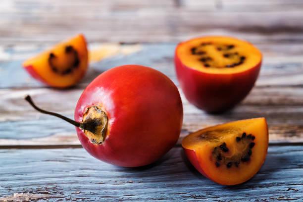Ripe Tamarillo fruit with slices stock photo
