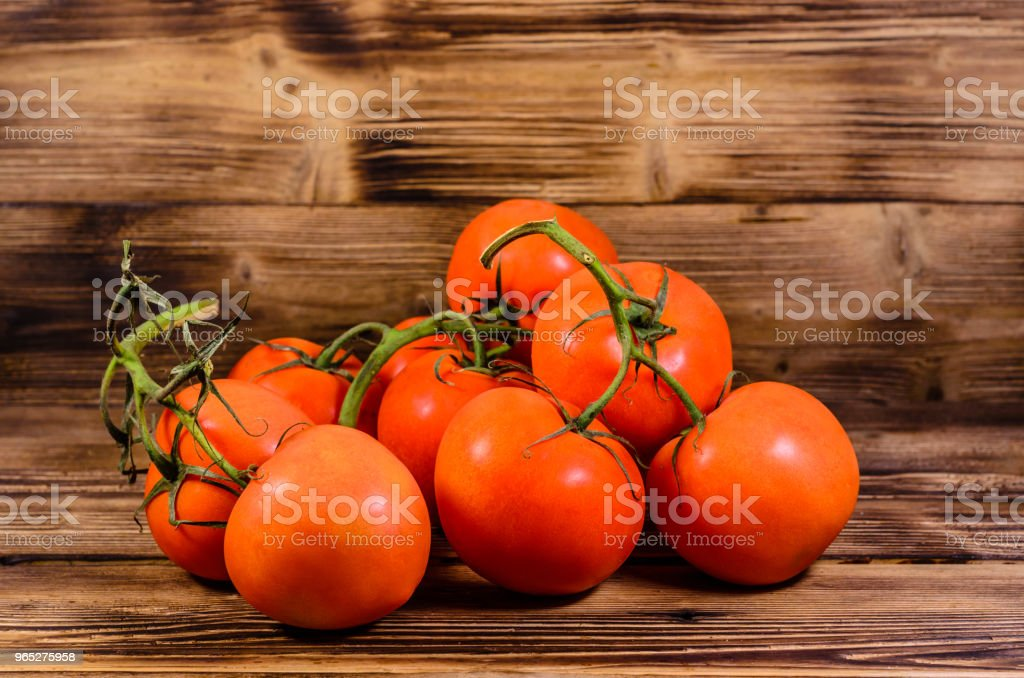 Ripe tomatoes on wooden table royalty-free stock photo