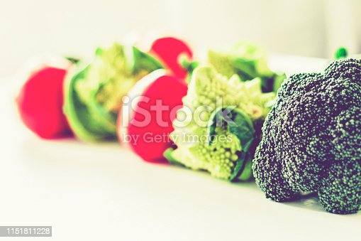 Ripe vegetables tomatoes romanesco broccoli on white wooden background with copy space for your text.