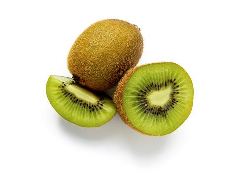 Ripe whole kiwi fruit and half kiwi fruit isolated on white background. Full depth of field. vegan food concept
